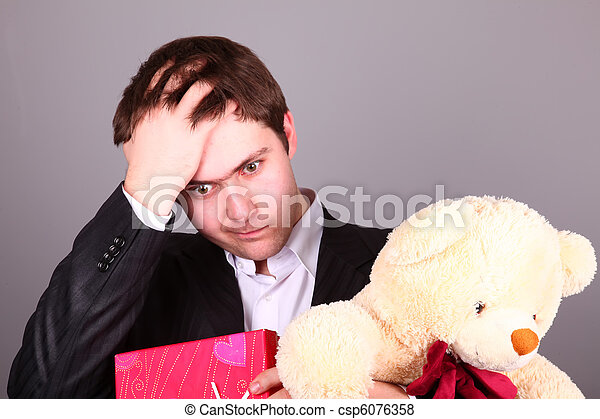 Boy with present box and teddy bear can't select a present in St. Valentine day - csp6076358