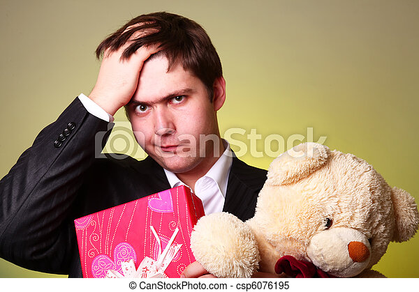 Boy with present box and teddy bear can't select a present in St. Valentine day - csp6076195