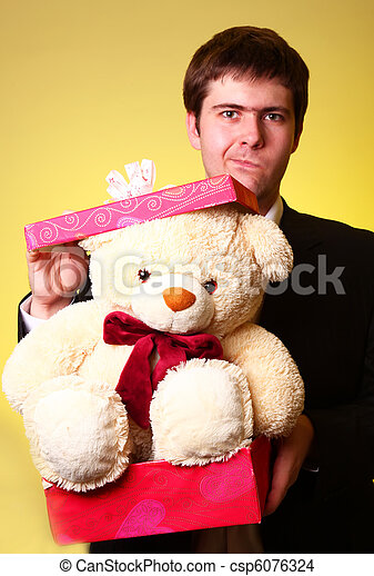 Boy with present box and teddy bear can't select a present in St. Valentine day - csp6076324