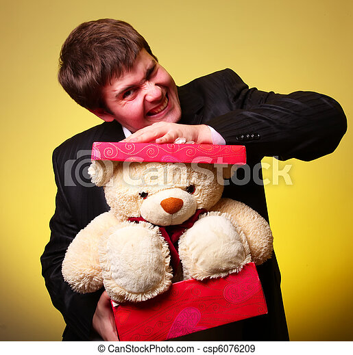 Boy with present box and teddy bear can't select a present in St. Valentine day - csp6076209