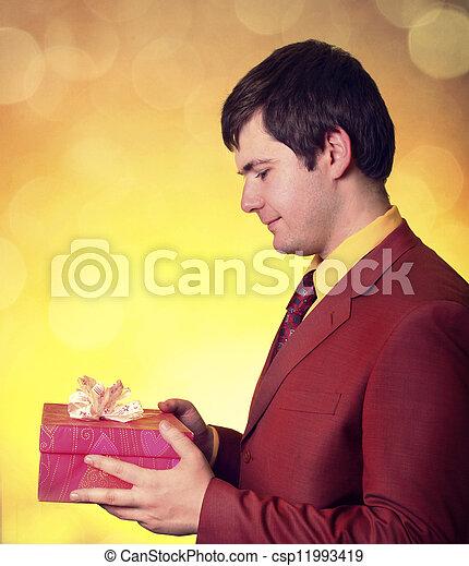 Boy with present box - csp11993419