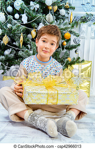 boy with present - csp42966013
