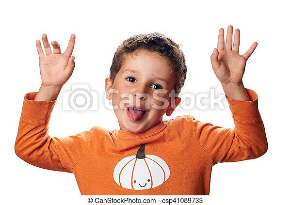 Boy with pumpkin on raglan is acting the ape - csp41089733