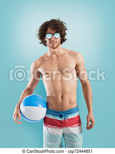 Boy with swimsuit on light blue background - csp72444851