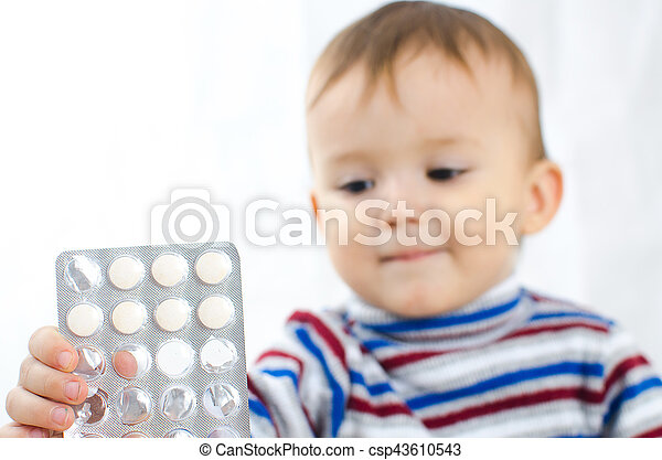 Boy with tablets in hands - csp43610543