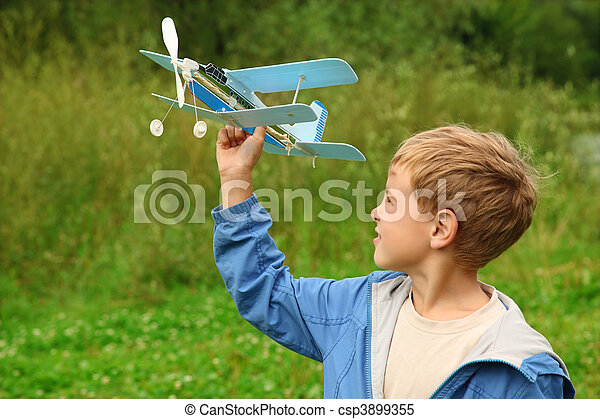 boy with toy airplane in hands outdoor - csp3899355
