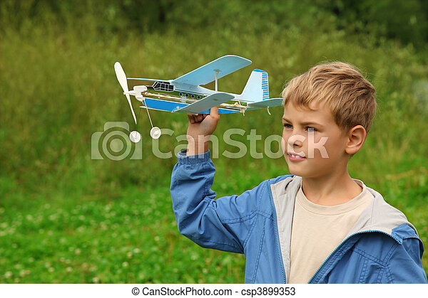 boy with toy airplane in hands outdoor - csp3899353