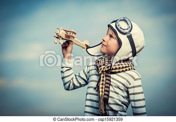Boy with wooden plane - csp15921359