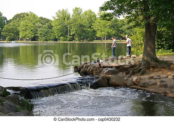 Boys fishing on the lake - csp0430232