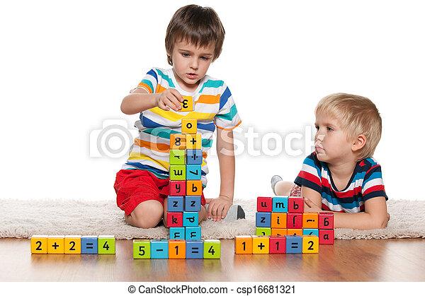 Boys with blocks on the floor - csp16681321