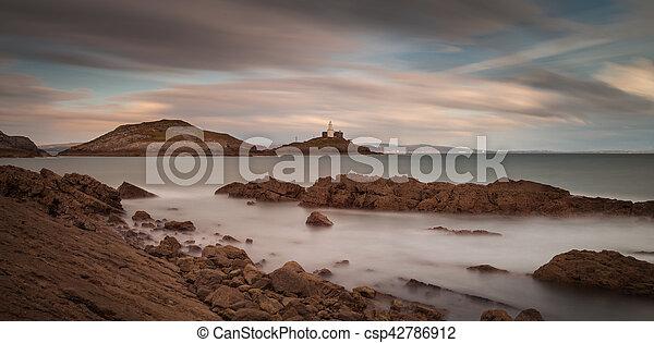 Bracelet Bay and Mumbles lighthouse - csp42786912
