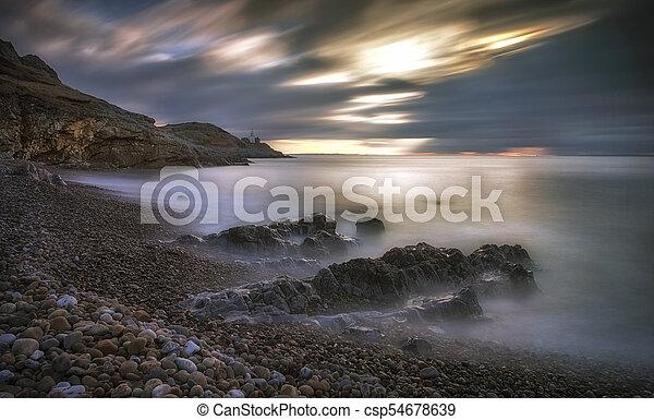 Bracelet Bay and Mumbles lighthouse - csp54678639