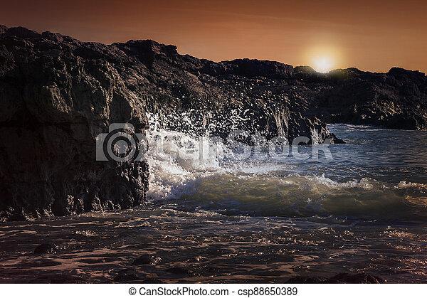 Bracelet Bay travel destination coastline at sunset by Mumbles on the Gower Peninsular West Glamorgan Wales - csp88650389