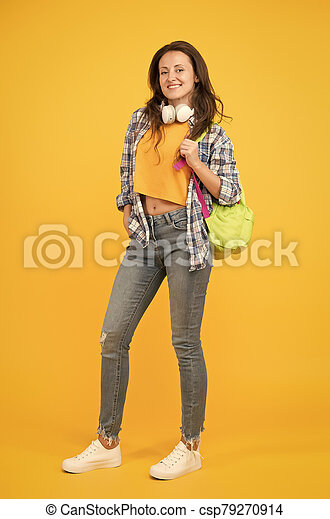 Brainy is new sexy. Happy student yellow background. University student carry backpack. Pretty student smile in casual wear. Senior high student.  back to school. University. Higher education - csp79270914