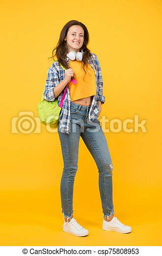 Brainy is new sexy. Happy student yellow background. University student carry backpack. Pretty student smile in casual wear. Senior high student.  back to school. University. Higher education - csp75808953