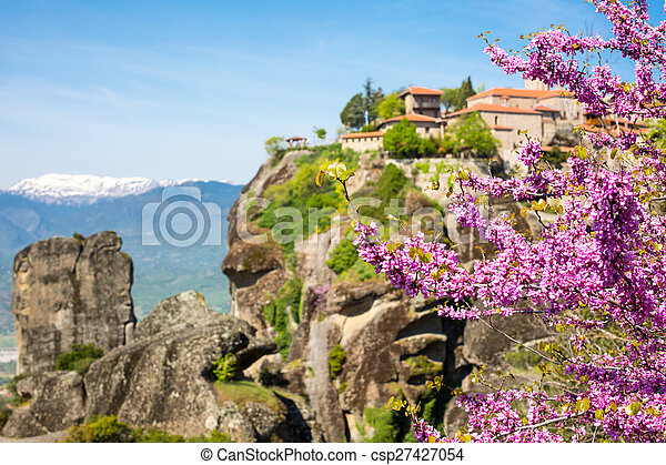 Branch of pink blossom and Great Meteoro Monastery in Meteora on the background - csp27427054