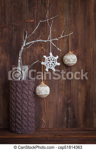 Branches With Vintage Christmas Toys In A Knitted Vase On The Wooden