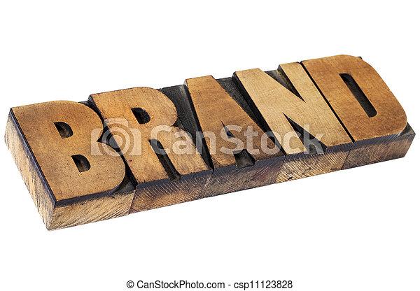 brand in letterpress wood type - csp11123828