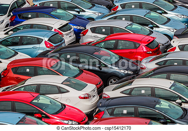 Brand new motor vehicles crowed in a parking lot - csp15412170