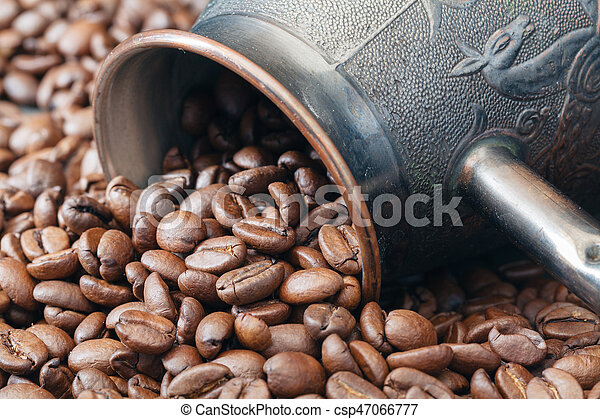 brass coffee pot on roasted beans - csp47066777