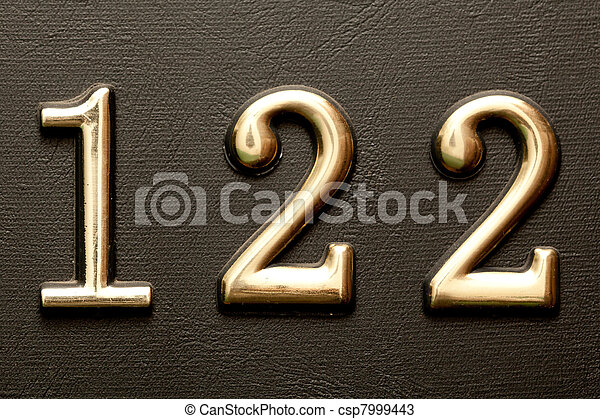 brass door number 122 on the dark leather background close up shot