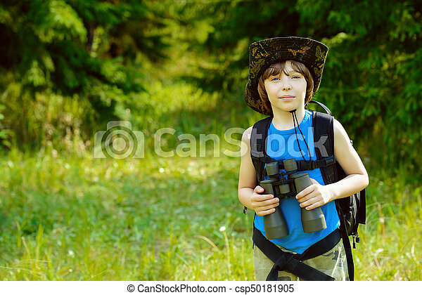 5f9d2afab3c Brave boy scout. Ten year old boy go hiking with backpack and ...