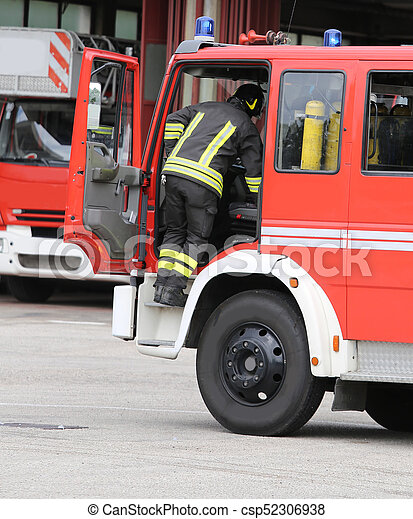 brave firefighters and their fire truck - csp52306938