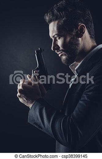 Brave man with handgun - csp38399145