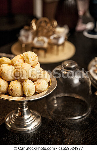 Brazilian Snack Cheese Bread Pao De Queijo On Silver Tray On A Dark Wood Table
