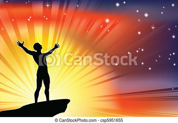 Hombre en la cima del precipicio con brazos levantados - csp5951655