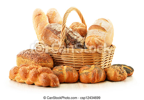 Bread and rolls in wicker basket isolated on white - csp12434699