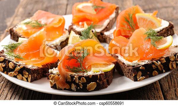 bread canape with salmon - csp60558691