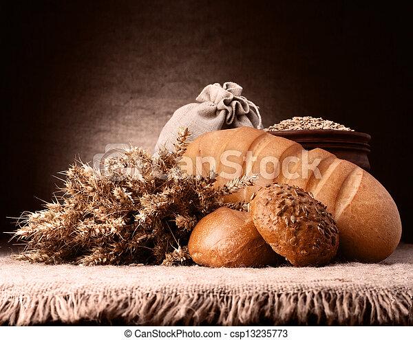 Bread, flour sack and ears bunch still life - csp13235773