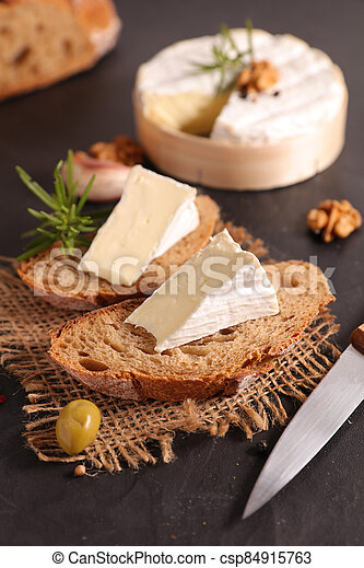 bread slices with portion of camembert - csp84915763