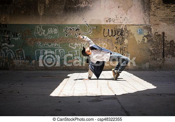 Breakdancer performing in an urban setting - csp48322355