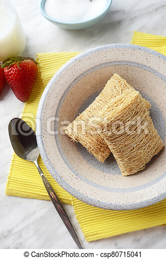 breakfast bowl of shredded wheat with strawberries - csp80715041