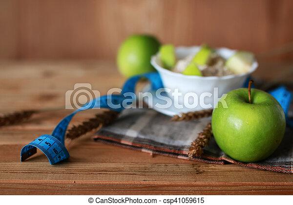 Breakfast diet fruit apple centimeter - csp41059615