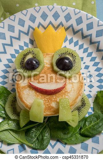 Breakfast for kids - frog prince pancake - csp45331870