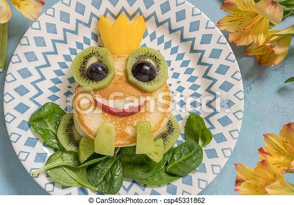Breakfast for kids - frog prince pancake - csp45331862
