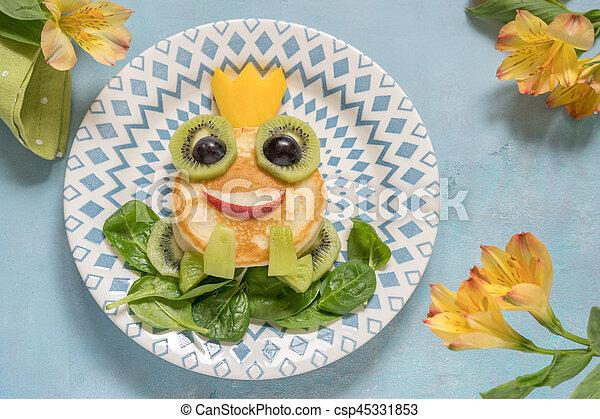 Breakfast for kids - frog prince pancake - csp45331853