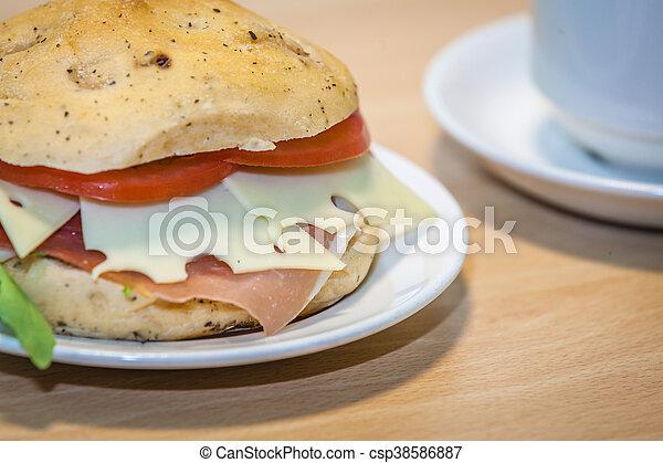 Breakfast ham, cheese and tomato bun - csp38586887