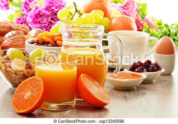 Breakfast including coffee, bread, honey, orange juice, muesli and fruits - csp13343596