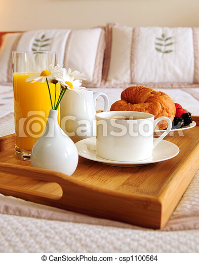 Breakfast on a bed in a hotel room - csp1100564