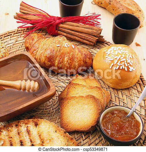 breakfast on rustic wooden table - csp53349871