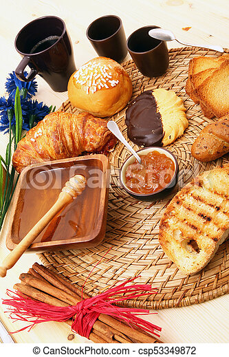breakfast on rustic wooden table - csp53349872