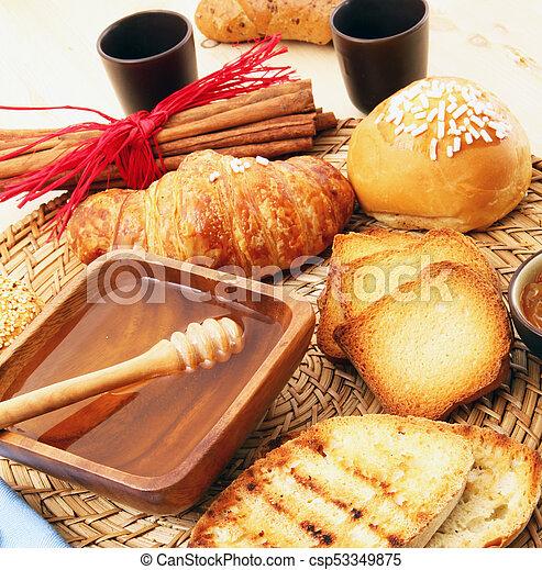 breakfast on rustic wooden table - csp53349875