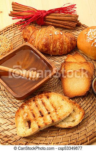 breakfast on rustic wooden table - csp53349877