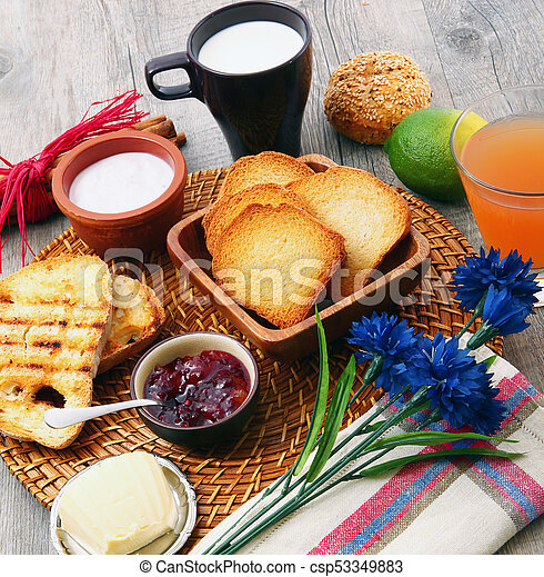 breakfast on rustic wooden table - csp53349883