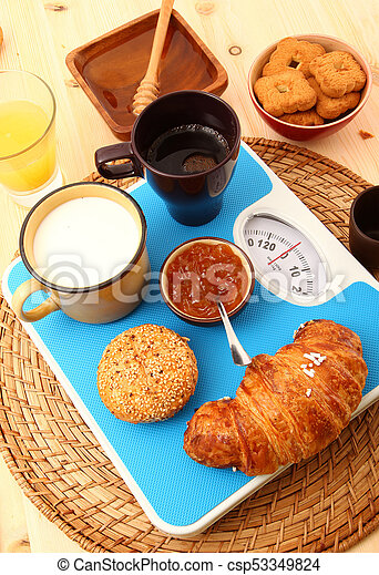 breakfast on rustic wooden table - csp53349824