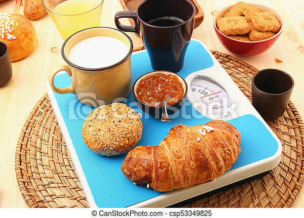 breakfast on rustic wooden table - csp53349825